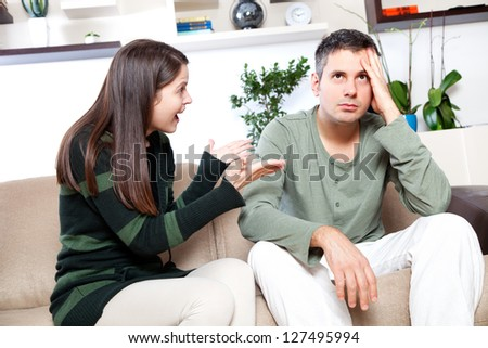 Image of young couple having quarrel