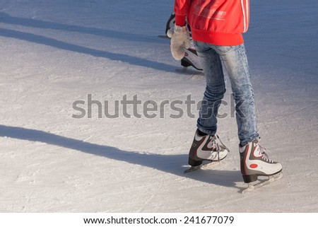 Image of young girl who are ice skating at the ice rink outdoors at Medeo
