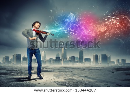Image of young handsome man playing violin - stock photo