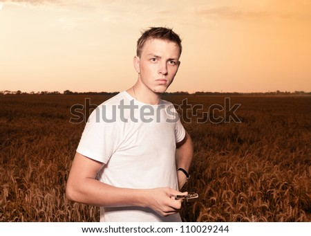 Image of young man on wheat field