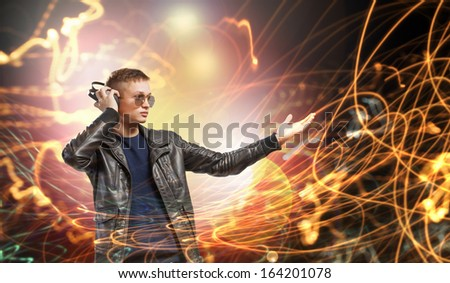 Image of young man rock musician at concert