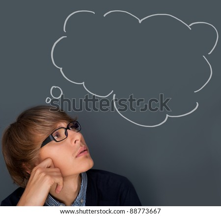 Image of young man thinking of his plans. Lots of copyspace inside graphic cloud for your text