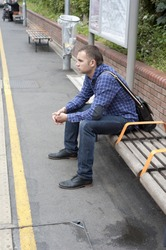 Image of young man waiting train