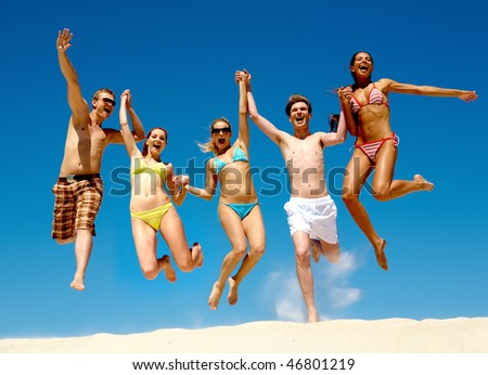 Image of young people jumping together outdoor