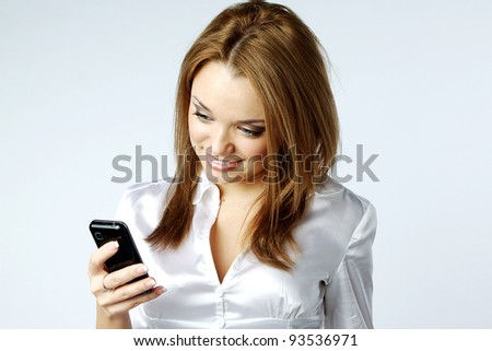 Image of young pretty people receiving SMS on your mobile phone - stock photo