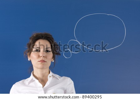 Image of young woman thinking on green board - stock photo