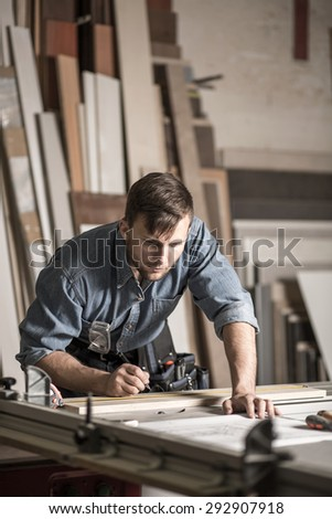 Image of young woodworker working in carpentry