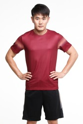 Image portrait of Young Asian handsome strong sport man in red t-shirt black pants and sports shoe with hand stand feet waist isolated on white background