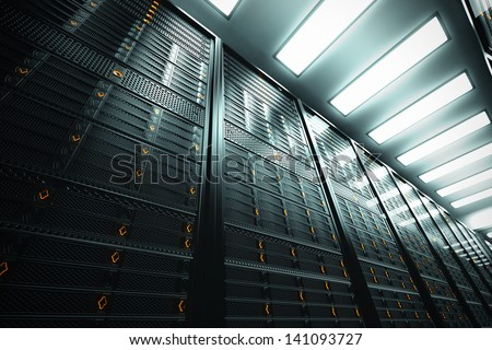Image presents a bottom view of a room equipped with data servers. Yellow LED lights are flashing.