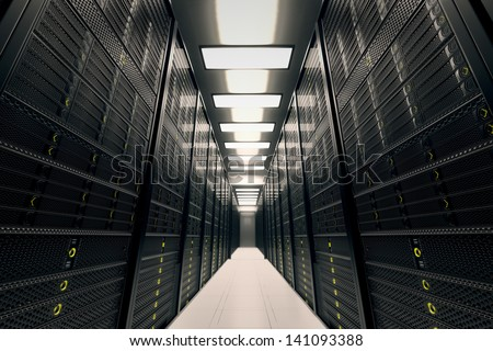 Image presents a room equipped with data servers. Yellow LED lights are flashing. Image can represent cloud computing, information storage, etc. or can be the perfect technology background.