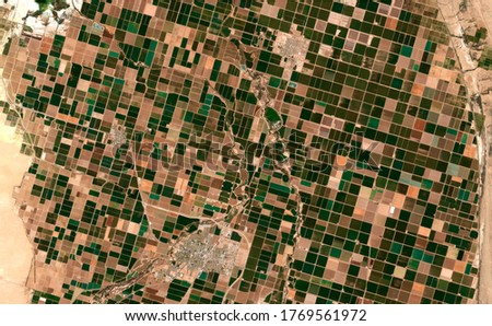 Image satellite of the presence crops and andcities. Sonora desert of Brawley, California, EUA. Observation of the surface of the earth from the sky. Generated and modified from satellite images.