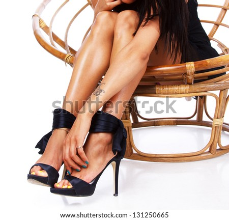 Image sexy female legs in heels with bow and elegant hand