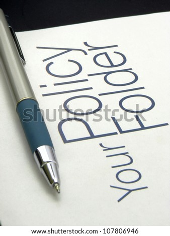 Image showing text policy Folder with pen on isolated white background.