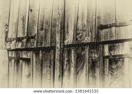 Image shows a barn door with a Sepia preset.
