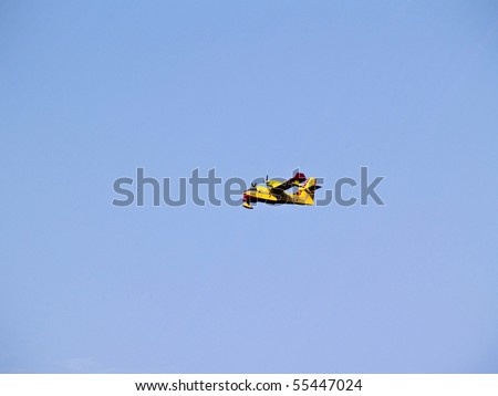 Image shows a firefighter plane in action