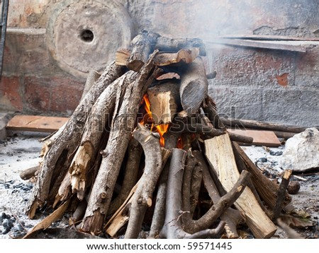 Image shows a fireplace background in old village outdoor