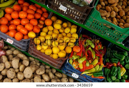 Image shows a fruit and vegetable market stand