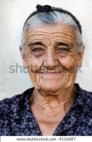 Image shows a happy old lady from a village in Greece