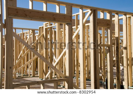 Image shows a home under construction at the framing phase.  Ideal for new construction advertising and other home construction promotional inferences