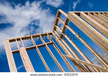 Image shows a home under construction at the framing phase.  Ideal for roofing advertising and other home construction promotional inferences.