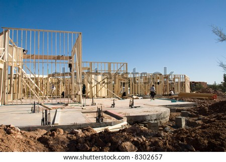 Image shows a home under construction at the roofing phase.  Ideal for roofing advertising and other home construction promotional inferences.