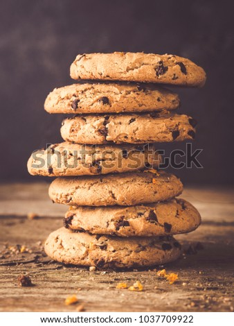 image shows a stack of american chocolate chip cookies on rustic wooden plank #1037709922