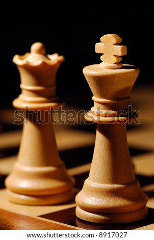 Image shows a white chess King and Queen