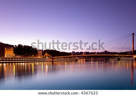Image shows bridges over the Saone river, in Lyon, France, photographed at dusk