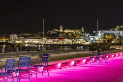 Image shows the cosmopolitan city of Cannes in the French Riviera, in the background illuminated city