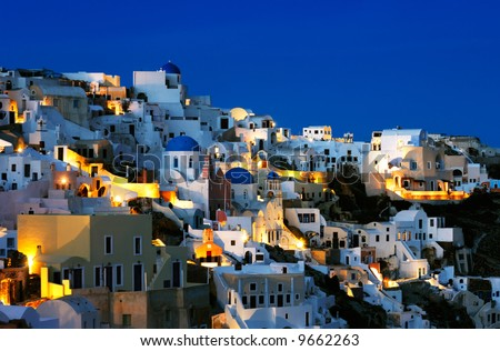 Image shows the village of Oia at dusk, on the beautiful island of Santorini, Greece