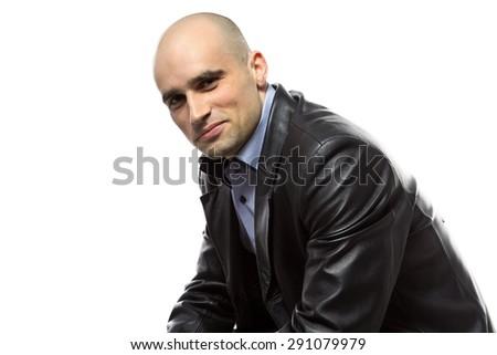 Image sitting hairless man in leather jacket on white background