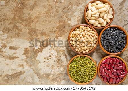 Image top view of soybean, red kidney bean, black bean, green bean, red bean and Peanut beans in wooden bowl with copy space