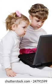 Stock photo: an image of two little girls with laptop