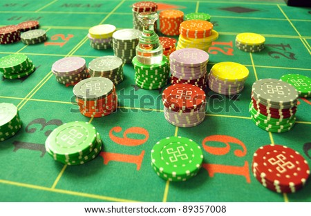 image with a casino roulette table layout with chips and dolly