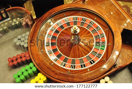 image with a casino roulette wheel with the ball bird eye view