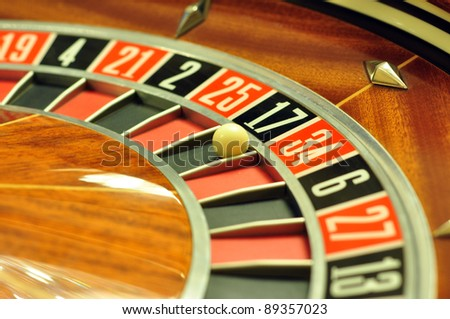image with a casino roulette wheel with the ball on number 17