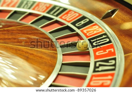 image with a casino roulette wheel with the ball on number 10