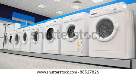 image with a display of washing machines in a market