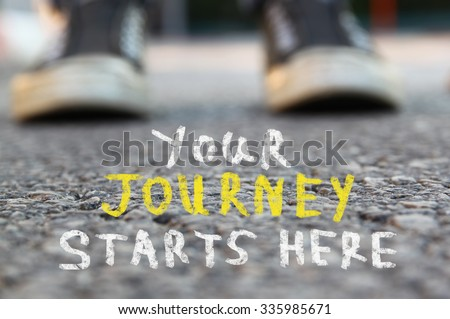 image with selective focus over asphalt road and person with handwritten text - your journey starts here.  education and motivation concept #335985671