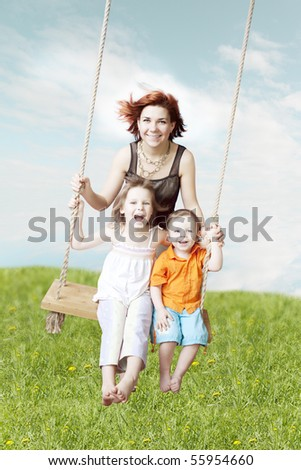 Images of the family swing against the sky and grass