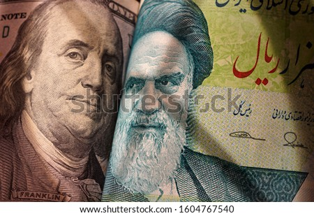 Images of US and Iranian symbols on banknotes in the context of international politics. USA. Iran.