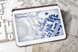 Imaginary cadastral map of territory with buildings and land parcel - concept image with a digital tablet - Note: the map background is totally invented and does not represent any real place.