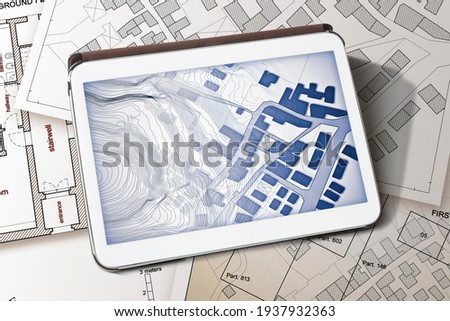 Imaginary cadastral map of territory with buildings and land parcel - concept image with a digital tablet - Note: the map background is totally invented and does not represent any real place. Сток-фото ©