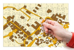 Imaginary cadastral map of territory with buildings, roads and land parcel - land registry concept in jigsaw puzzle shape
