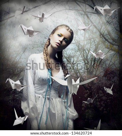 Imagination Romantic Blonde with Hovering Origami Birds in Spooky Forest Magic