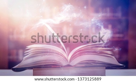 Imagine a picture book of an ancient book opened on a wooden table with a sparkling golden background. With magical power, magic, lightning around a glowing glowing book In the room of darkness