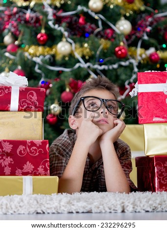 imagined boy with glasses in  New Year\'s Eve with  box gifts