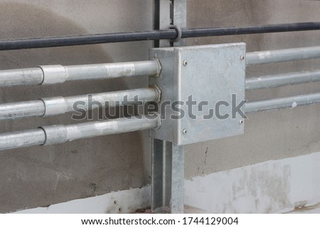 Imc conduit installed on support For Electrical systems,Waterproof conduit Stock photo ©