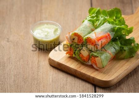 Imitation crab stick fresh vegetable salad rolls. Photo stock ©