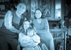 Imitation of antique portrait of happy family with Christmas tree at home